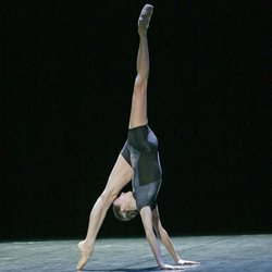 "Marie-Agnès Gillot in a performance of ""Genus,"" created by young British choreographer Wayne McGregor. The work was inspired by Charles Darwin's ""On the Origin of Species."""