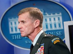 Newly embattled U.S. Army Gen. Stanley McChrystal listens during a daily brie...
