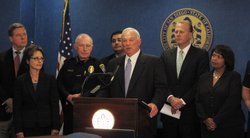 San Diego Mayor Jerry Sanders stands with city officials as he unveils new pl...
