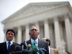 Otis McDonald (C), lead plaintiff, and his legal team speak to reporters afte...