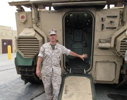 Expeditionary Fighting Vehicles program manager Col. Keith Moore shows off the new amphibious vehicles at Camp Pendleton on June 29, 2010.