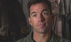 Lieutenant Commander and F-18 pilot Kevin McLaughlin served as both safety of...