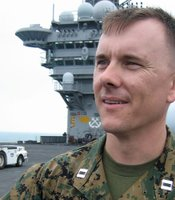 "Major Justin Knox served as a captain and F-18 pilot with Marine Fighter Attack Squadron 232 (VMFA-232), also known as ""The Red Devils,"" during the deployment featured in ""Carrier."""
