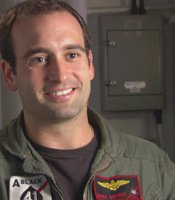"Doug Booher served as a lieutenant and F-18 pilot with Strike Fighter Squadron 41 (VFA-41), also known as ""The Black Aces,"" during the deployment featured in ""Carrier."""