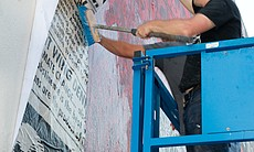 Shepard Fairey works on his piece at 5th and Un... (5460)
