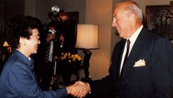 President Corazon Aquino of the Philippines shakes hands with George Shultz.