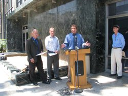 San Diego Assemblyman Marty Block speaks outside the California State Department Office in San Diego on Front Street.
