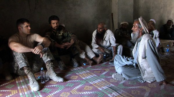 "The soldiers meet with local Afghan villagers in ""Restrepo"""