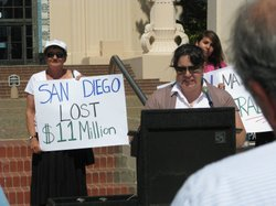 Community advocates protest outside a San Diego County Administration buildin...