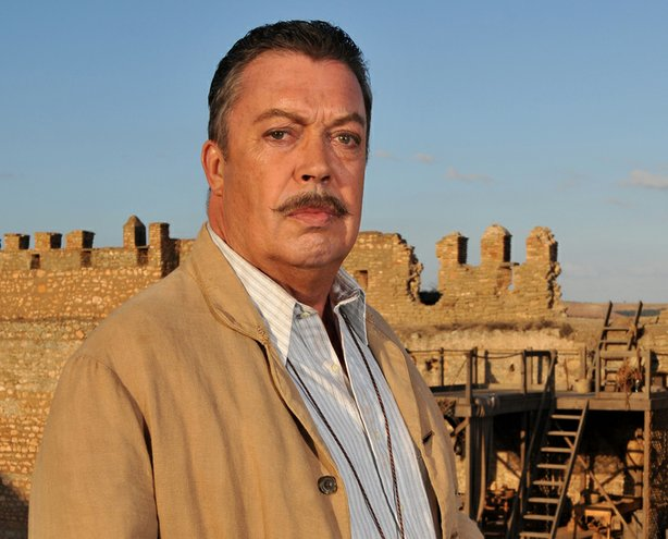 An archaeological dig is the scene of murder in the Middle East, leading Poirot to unravel a tragic tale of twisted family secrets. The cast of suspects includes co-star Tim Curry (pictured).