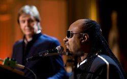 Stevie Wonder performs, with Paul McCartney looking on, as President Barack O...