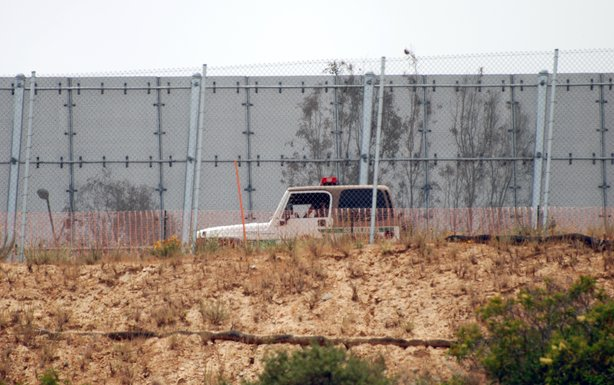 Border Patrol at the fence which separates the U.S. from Mexico in southwest San Diego County, July 19, 2010.
