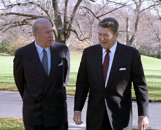 George Shultz (left) and Ronald Reagan walking