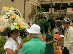 Ana Flora Royer and Lori Shelton chat with fellow racegoers about their entir...