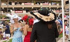 These women were all competing in the various hat contests and socializing th...