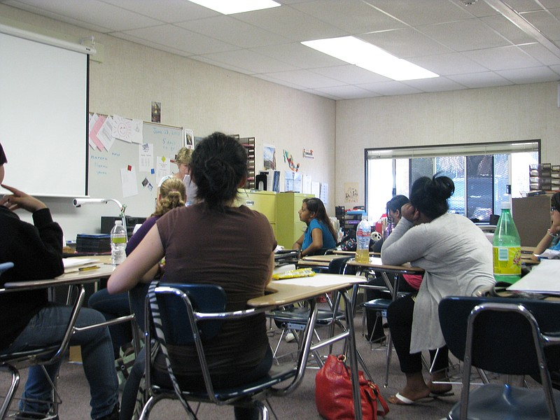 A group of high school students in Vista goes over their classroom ... ()
