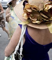 Hats are worn by most of the women attending opening day, whether they are competing in the contests or just celebrating the opening of the racing season.