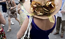 Hats are worn by most of the women attending opening day, whether they are co...