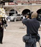 One of the television reporters did her stand-up trying to balance a large floral hat.