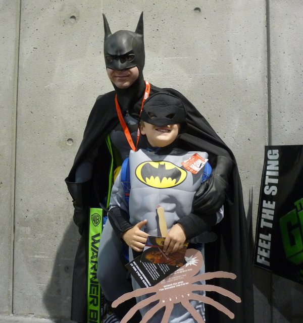 My little Batman friend finds a bigger Batman to pose with.