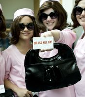 These women were dressed up as Jackie Kennedy Onassis to promote a book. The one holding the purse is our lovely KPBS intern Hilary!