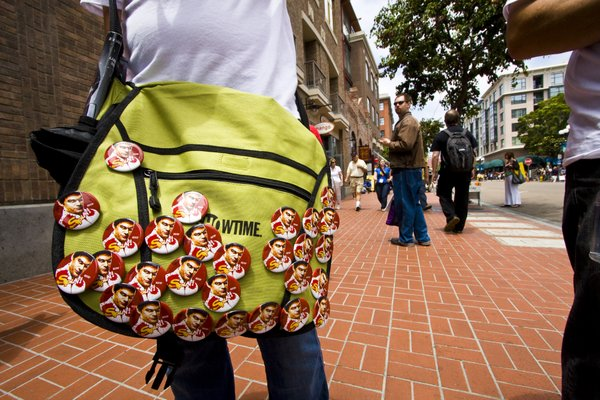 "A courier bag covered in buttons advertising the Showtime series ""Dexter."""