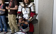 A member of the Society for Creative Anachronism rests after a combat demonst...