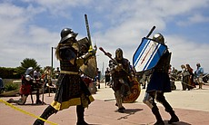 SCA members fight with swords (made of rattan) and real armor (very heavy). T...