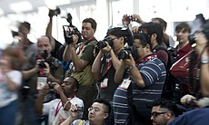 A crowd of photographers gathered at the sight ...