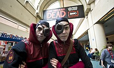 Comic-Con attendees dressed as members of the Guild of Calamitous Intent, a s...