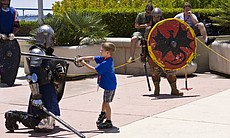 "After the combats, the participants invite the kids in the crowd to enter the ring and learn how to sword fight. They call it ""Whack-a-Knight."""