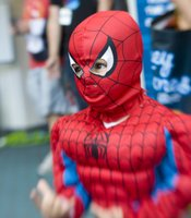 A young Spiderman demonstrates how he would shoot his web at Comic-Con International.