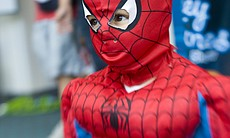 A young Spiderman demonstrates how he would shoot his web at Comic-Con Intern...