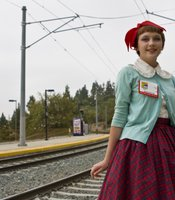 Bridget Fitch is a 17-year-old San Diegan who dresses in Lolita style, notable here by the red bow.  I met her on the trolley on the way to the San Diego Convention Center for Comic-Con, 2010.