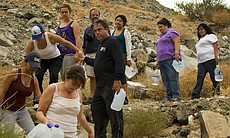 Border Angels drop bottles of water in the dese...