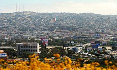 The Mexican flag in Tijuana can be seen prominently from the U.S. side of the...