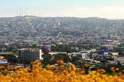 The Mexican flag in Tijuana can be seen prominently from the U.S. side of the border. Tijuana is the sixth-largest metropolitan area in Mexico with a population of 1.5 million. By comparison, San Diego County has about 3 million people.