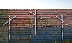 On the Mexican side of the fence, crosses repre...
