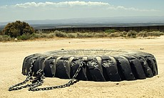 A tractor tire is pulled behind Border Patrols ...