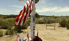 A cross stands where Border Patrol Agent Robert Wimer Rosas Jr. was killed wh...