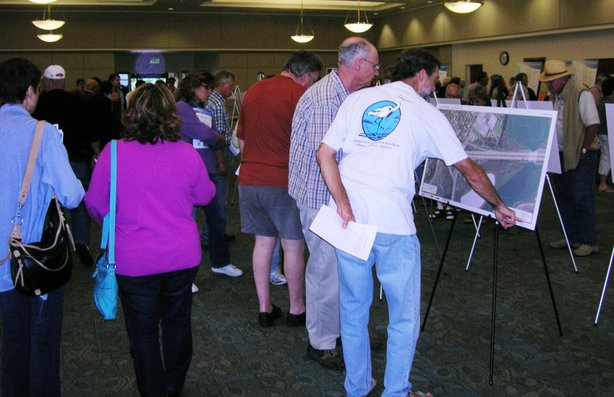 Community members poured over images of the proposed I-5 expansion at a CalTrans open house July 27.
