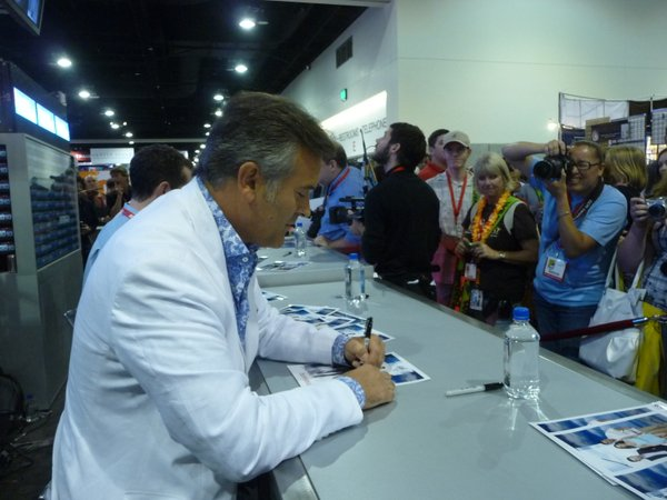 "Bruce Campbell signed autographs at the Fox booth after appearing at the ""Burn Notice"" panel."