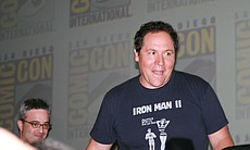 """Cowboys vs. Aliens"" director Jon Favreau leaving his panel in Hall H on Saturday night. (Photo by: Tony Weidinger)"