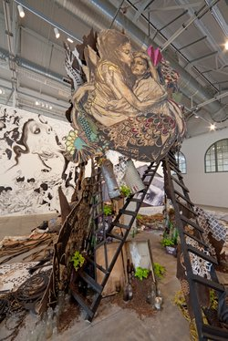 "Detail from Swoon's ""Swimming Sisters of Switchback Sea"" (2008). Hand-painted block print on wood with found objects."