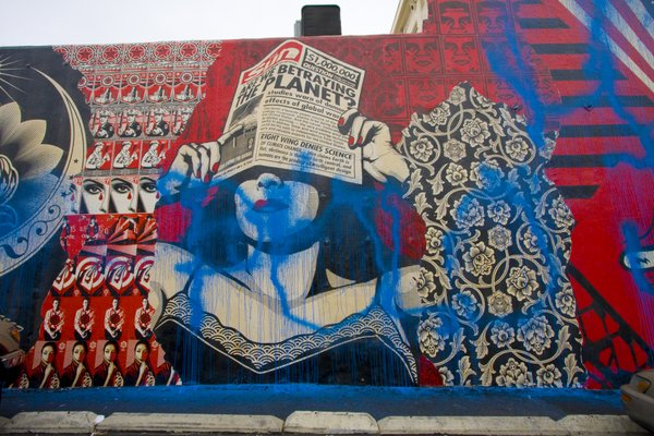The mural is on the side of Urban Outfitters. Employees arrived at 6a.m. August 6 and discovered the blue spray paint.