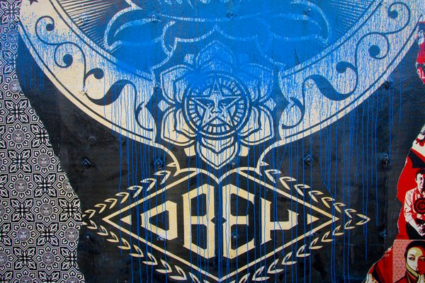 A close up of the tag over Shepard Fairey's mural in Hillcrest.