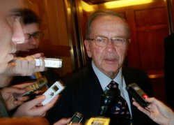 Sen. Ted Stevens (D-AK) is trailed by reporters as he walked off the Senate F...