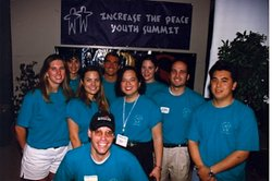 "KPBS Director of Community Engagement and Grants, Monica Medina (center) with staff and volunteers at the second annual ""Increase the Peace Youth Summit"", 1997."