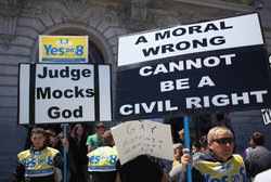 Opponents of same-sex hold signs outside of San Francisco city hall after a d...