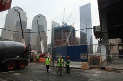 Workers leave Ground Zero, near a proposed site of an Islamic cultural center and mosque in New York, NY.